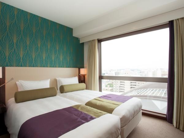 【ハリウッドツイン】シングルベッド2台が並んだお部屋になります。