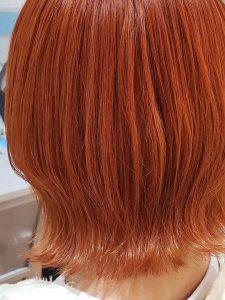 切りっぱなしボブでオレンジカラーのイメージ・テイスト画像